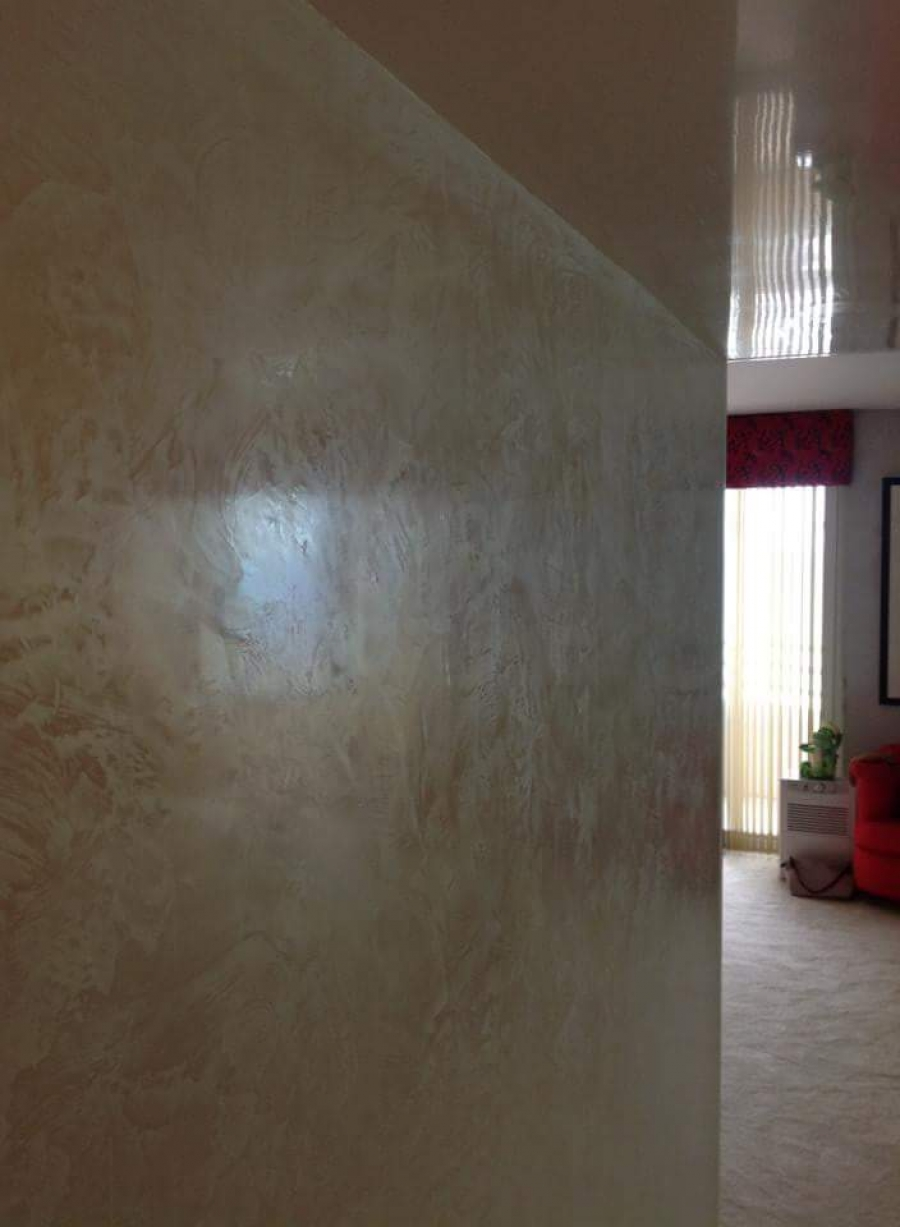 Super high gloss venetian plaster makes your small entrances look wider or higher. Its like having a real mirror on the ceiling in any desired color. The old world venetian is a great compliment on the wall right next to it.